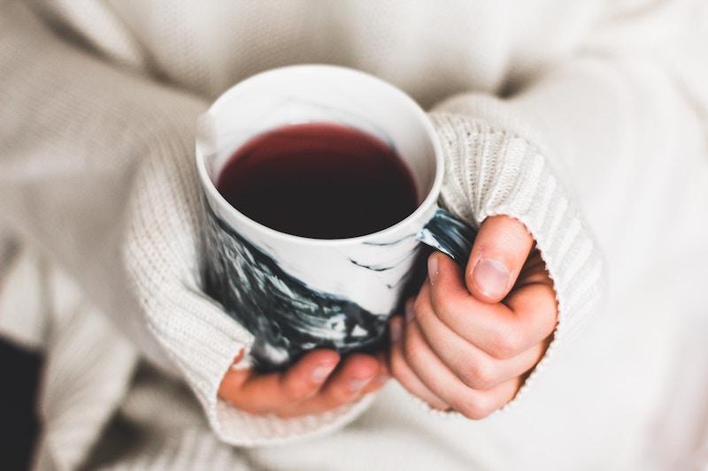 kira-auf-der-heide-unsplash close coffee in hands2.jpg